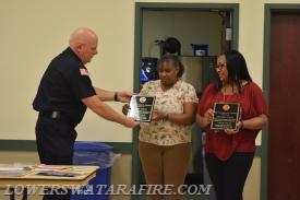 Chief Weikle presenting awards to Mavis Dixon and Jennifer Dixon