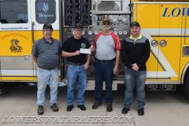 Members of Liberty Hose Company complete the sale of Engine 59 with Trustee Gallagher